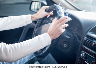 Man smoking a cigarette at the wheel of a car. Driving and smoking