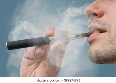 Man is smoking e-cigarette.