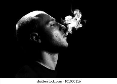Man Smoking on black background