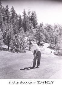 Man smoking pipe while playing golf