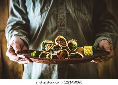 Man with snacks and dips. Tortilla mexican food. Party food. Chef with tapas