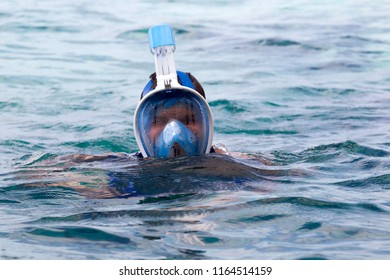 man with snorkel mask tuba and snorkel in sea. Snorkeling, swimming, vacation.