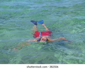 man snorkeling in Cozumel