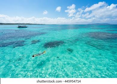 Man snorkeling in Tropical lagoon paradise of Ishigaki island, Okinawa, Japan