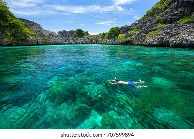 Man snorkeling in tropical turquoise water
