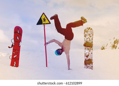 the man the snowboarder head over heels against the background of mountains
