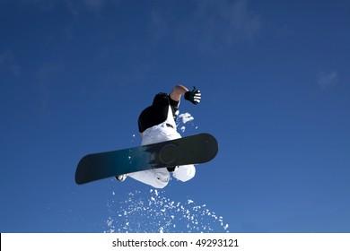 man snowboarding doing acrobatic figures