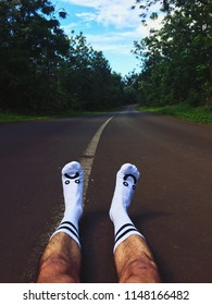 Man With Socks Enjoying Life in the Middle of The Highway