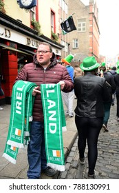 A man sold scarfs on St. Patrick`s Day Parade in Dublin, Ireland, March 18th 2015