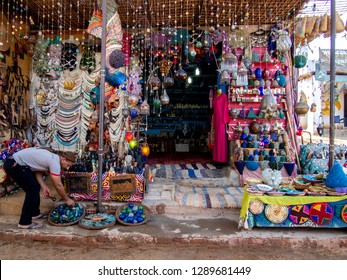 A man in a souvenir shop for tourists. Nubia, Aswan, southern Egypt, August 14, 2014