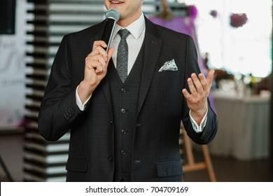 the man speaks into the microphone