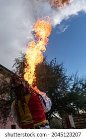 man spitting fire, A Jester fire-eater performance