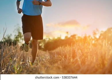 Man in sport cloth,Athletic young man running in the nature. Healthy lifestyle