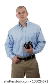 man in sporty casual wear poses with old camera