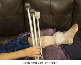 Man With Sprained, Broken, Fractured Ankle Grabs His Crutches