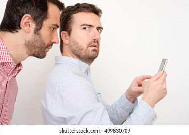 Man spying the mobile phone of another person