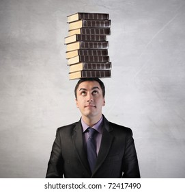 Man with stack of books on his head