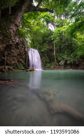 A man stand on the waterfall in natural deep forest