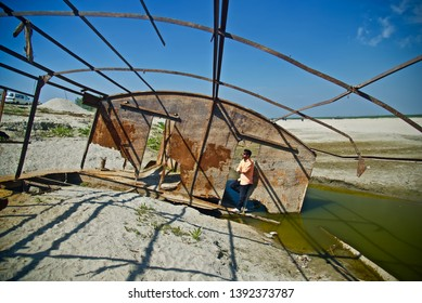 Man standing in an abandoned place around a coastal area