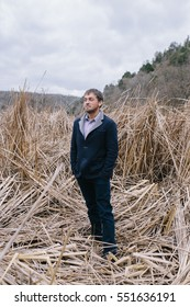 man standing in the among of the reeds