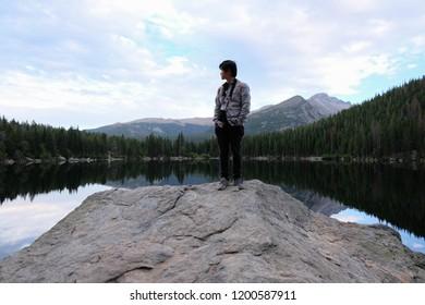 Man standing at the beautiful lake