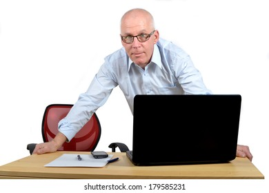 man standing behind the desk with a blue shirt