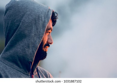 Man is standing beside the burning fire with smoke background unique stock photograph.