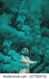 man standing with blue smoke bomb artistic wallpaper vertical