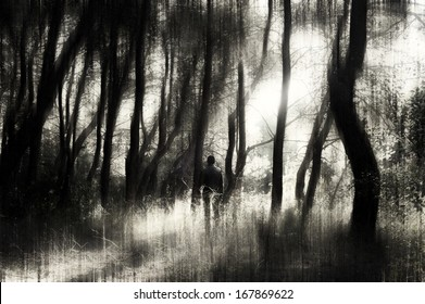 Man standing in a dark forest