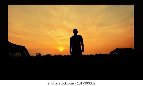 man standing in the evening and sunset