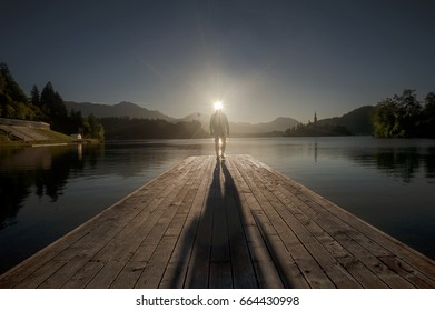 Man Standing at Famous Bled Lake National Park Slovenia,