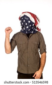 Man standing with fist raised and American flag over his head as a hood.
