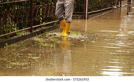 Man standing in  flooded road