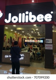 A man was standing in front of Jollibee outlet in Vincom Plaza, Danang, Vietnam (14 February 2017)