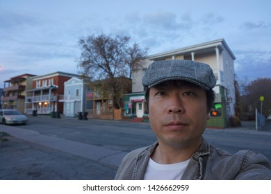 a man standing in front of rue alexandre of sherbrooke town on the townships trail of eastern townships in quebec, canada