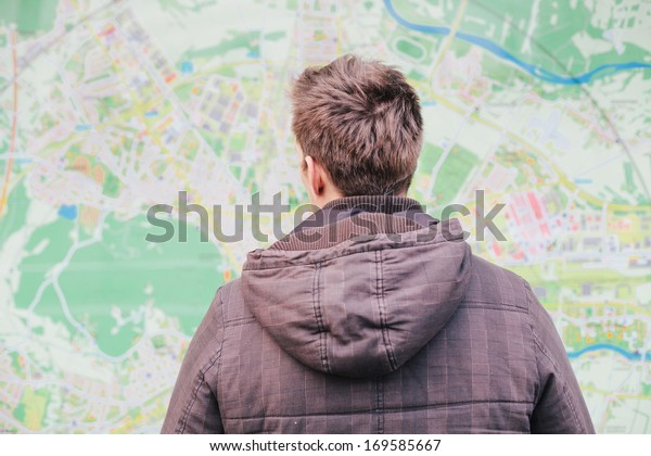 Man standing in front of tourist city map