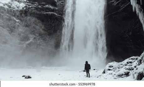 Man standing in the front of waterfall, Skogafoss waterfall Iceland