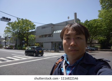 a man standing at hillside terrace area of daikanyama in tokyo, japan