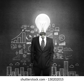 man standing with light bulb in head