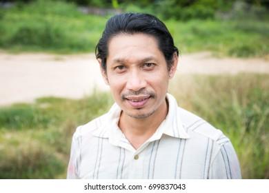 Man standing and looking at camera,Asian man