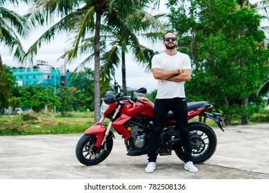 Man standing near his motorbike