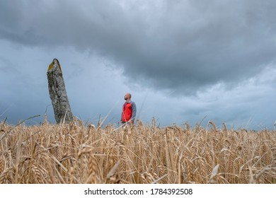 Man standing next to Cú Chulainn standing Stone in Co. Louth. Ireland. July 2020