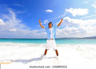 Man standing on the beach.
