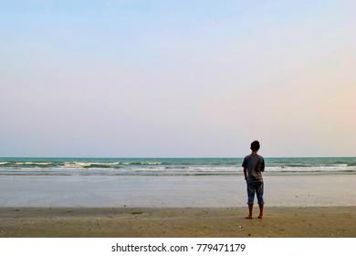 Man standing on the beach and enjoying great view at Prachuap Khiri Khan province, Thailand.