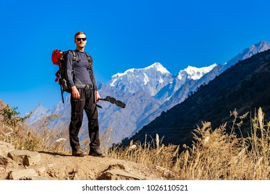 Man standing on beautiful Himalaya mountains with a blue sky background on a sunny December day during Manaslu circuit trek.