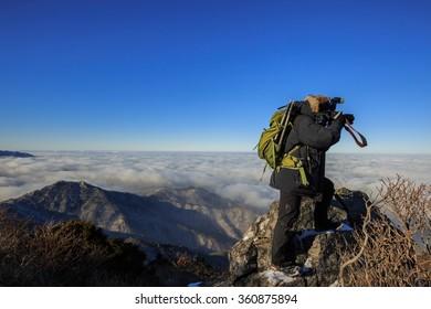 A man standing on a Deogyusanmountain photography.