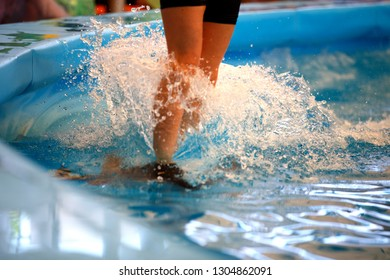 man standing on dilphin and swimming very fast in water