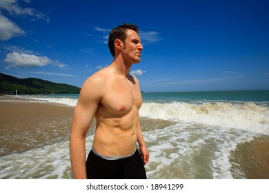 Man standing on exotic beach