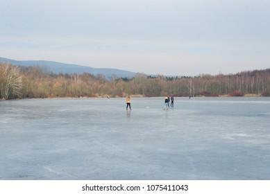 Man standing on frozen ice lake natural