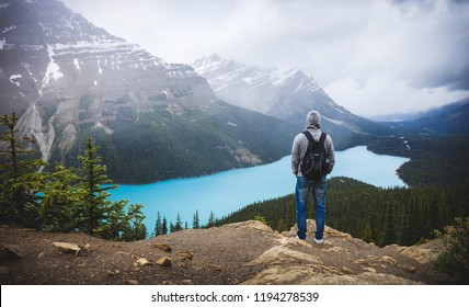 Man standing on the hill in front of Peyto Lake, Alberta, Canada.